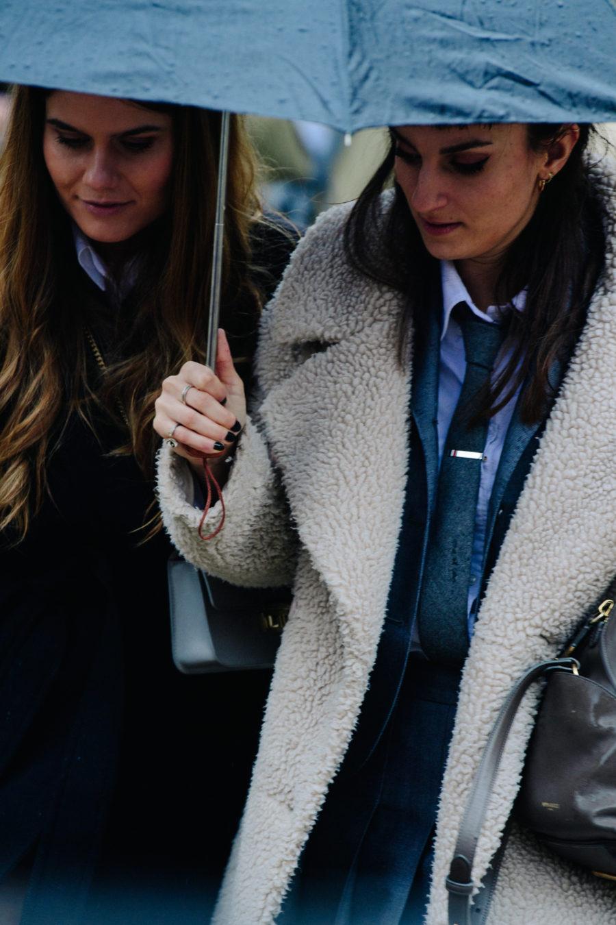 Women carrying umbrellas