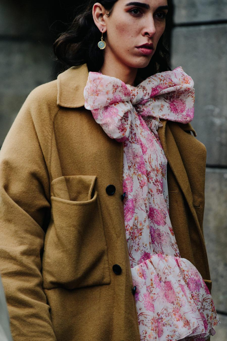 Woman wearing pink scarf